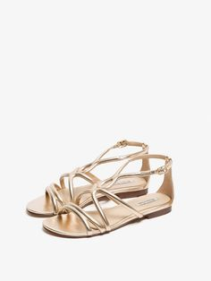 70d5d922a Tube-shaped sandals made from caprine leather with a metallic finish and  golden buckle detail on the side. Outsole with welt wheel and logo detail.