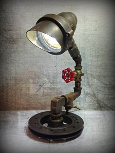 Incognito © - Found Object Light Sculpture by Assemblage Artist, Jay Lana