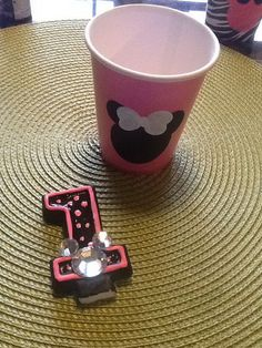 The beautiful pink favor cup with Mouse heads hand painted on them and a candle painted black and pink with a rhinestone Minnie. They must be the perfect combination for any Minnie Mouse themed party.