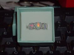 LOOK!!!! A GORGEOUS STERLING SILVER WHITE FIRE OPAL AND AAAAA CZ RING SIZE 8