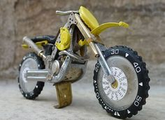 Trials Bike from recycled watch parts.  http://hometipster.com/recycled-watch-art/