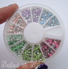 Find the full post here : http://www.naileditnz.com/2013/09/pink-purple-blue-rose-nail-art-pastel.html Use these pastel studs  : http://www.bornprettystore.com/400pcs-round-square-fluorescent-lighter-colors-stud-rhinestones-nail-decoration-wbox-p-7218.html Use the code CEL91 to get -10% discount.