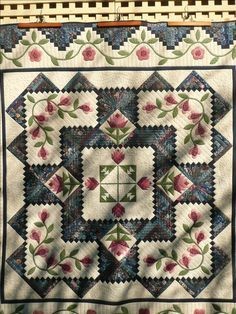 Log Cabin quilt with pieced flowers. Great border. http://www.mqresource.com/home/images/stories/sparkinson/mannum%20retreat%20005.jpg