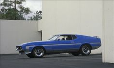 1971 Ford Mustang Boss 351 - 351 cu in Cleveland V8 engine catapulting the car to a 5.8 seconde zero to 60 mph time and a 13.8 second quarter mile.