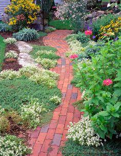 Rockport, Cape Ann, MA Summer flowers boarder a brick pathway in a Rockport garden