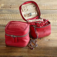 """LETTER PERFECT JEWELRY CASE--Uniquely hers, a red leather jewelry case personalized with her initial and offering safe storage—six pockets in all—for precious trinkets and jewels. Microsuede lining. Zip closure. Exclusive. Approx. 4-3/4""""W x 4-1/2""""D x 4-1/2""""H."""