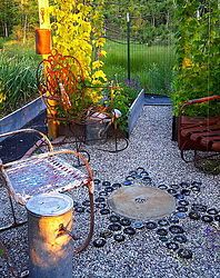 "Buried beer, wine and booze bottles create a ""star"" statement in this Michigan garden."