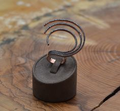 A personal favourite from my Etsy shop https://www.etsy.com/listing/278468120/geometric-spiral-ring-silver-spiral-ring