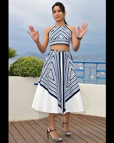 Freida Pinto knows a thing or two about stealing the limelight - and here does it with aplomb in geometric-print, figure-flattering Salvatore Ferragamo Resort 2012 style at Cannes.