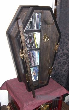 coffin CD holder- I want one for my books that I don't want the kids to lose, lol. Cd Dvd Storage, Diy Storage, Dvd Organization, Storage Ideas, Storage Units, Storage Boxes, Movie Storage, Record Storage, Gothic Furniture