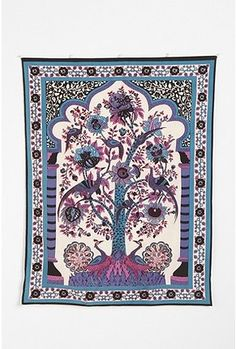 Peacocks in a tree tapestry.