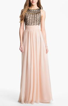 Love the sequin bodice of this stunning blush colored chiffon gown!