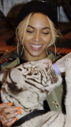 Beyonce at Blue Ivy's 2nd birthday 2014--I would be nervous and if she is, you can't tell