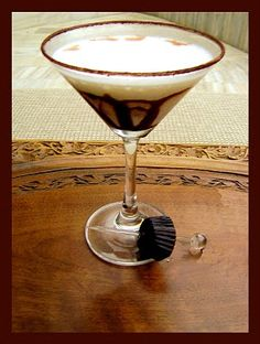 Want to have it? :)  Ingredients are as follows:  1 shot of Chocolate Flavoured Vodka ('Remix' in India), 1 cup Vanilla Ice-Cream, 1 drop Vanilla Essence, 1 tsp Caramel Flavoured Syrup, Ice as required, Chocolate Sauce, Cocoa Powder.