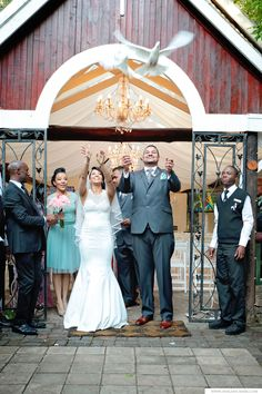 """This lovely couple said """"I do"""" 26 September 2015 at Oakfield Farm. DJ – Mixolydian MusicVideographer – Mixolydian MusicBridesmaid dresses – Martha GeyerWedding dress – Altered by Martha GeyerHair – Veaan ElieMake-up – Deoni StrydomSuits – Black… Black Tie Invitation, Sitting In A Tree, Hush Puppies, Bridesmaid Dresses, Wedding Dresses, Hush Hush, Wedding Pictures, Dj, Fair Grounds"""