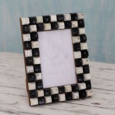 This handmade creation is offered in partnership with NOVICA, in association with National Geographic. The fun design of this photo frame is like a message waiting to be encrypted. From Mohd Tanveer,