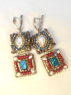 Check out this item in my Etsy shop https://www.etsy.com/listing/266332610/two-tier-earrings-encrusted-with-pearls