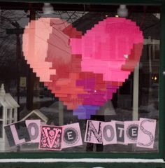 Valentines window display 'love notes' .large hearts created from post it notes
