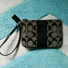 Coach wristlet Beautiful coach wristlet in a classic pattern. Has one main pouch inside and one smaller card sized pouch. Great for purses! Coach Bags Clutches & Wristlets