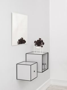 A careful combination of the Frame storage boxes alongside the Kubus Bowl and View mirror make for a light and inviting hallway.