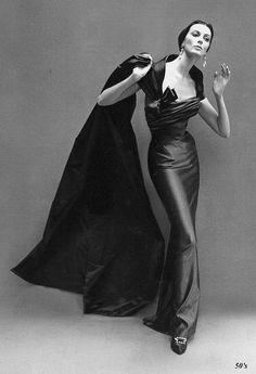 Carmen Dell'Orefice in a satin Balmain dress, photographed by Richard Avedon for Harper's Bazaar, October 1957.