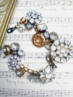 Vintage Rhinestone Button Bracelet #25  This bracelet has all vintage rhinestone buttons. There are so many different varieties and sizes, some with lacy bezels, some with clean setting and no prongs, some with gold tone settings, most with silver, all with various signs of age (which we love!)! ...