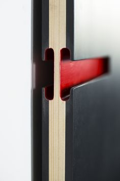Red door handle detail - ANCE Office in Piemonte Italy by +Studio Architetti Associati