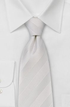 Google Image Result for http://white-neckties.com/wordpress/wp-content/uploads/2008/06/pure-white-tie-with-wide-stripes.jpg