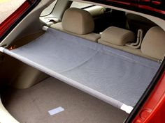 Make your own trunk cover with fabric and shower curtain rods