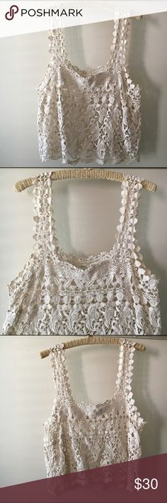 Urban Outfitters Knit Lace Off White Tank Top Worn a couple times. Great condition! Adorable. Especially with a bralette underneath. Floral patterns. Staring At Stars brand from Urban Outfitters. Good for COACHELLA! Urban Outfitters Tops Tank Tops