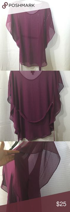 2b bebe Loose fuscia purple blouse. Includes sash. 2b bebe in Good condition‼️ Loose fitting aubergine color blouse that can be more fitted with the included sash. The shirt has large arm openings that begin to be sealed starting from  the sash holes downward. So your bottom torso is not exposed on the sides. Great with black skinny jeans! 2b bebe Tops Blouses