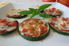 Grilled Zucchini - Zucchini Pizza is a healthy alternative to traditional pizza made with zucchini, pizza sauce, fresh basil, mozzarella cheese and cherry tomatoes