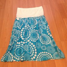 Strapless Babydoll dress Strapless Babydoll dress tube top material in white on top and bottom is teal with dot prints in white Dresses