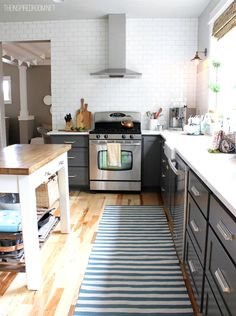 Love the gray, white subway tile with gray grout, and the drawers -- Kitchen Before & After: A Standard Builder's Kitchen Gets a Better Layout Kitchen Remodel   The Kitchn