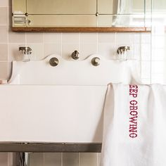 Pure linen hand towel with red embroidery. From Babylonstoren, South Africa Minimalist Home Decor, Minimalist Bathroom, White Napkins, White Sink, White Space, White Bathroom, Hand Towels, South Africa, Living Spaces