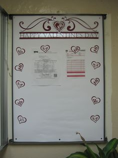 A fancy header and coordinating heart magnets announce Valentine's Day in this magnetic bulletin board .