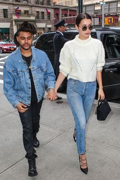 sweater bella hadid celebrity model celebrity style the weeknd singer white sweater sunglasses bag black bag sandals high heel pumps black pumps menswear mens jacket denim jacket mens pants mens boots Style Invierno, Abel And Bella, Beaux Couples, New Outfits, Fashion Outfits, Bella Hadid Style, Mens Fashion Sweaters, Fashion Models, Models Style