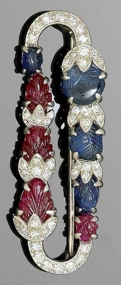"AN ART DECO RUBY SAPPHIRE AND DIAMOND BROOCH, CARTIER, CIRCA 1925. ""Tutti Frutti"" brooch consisting of a row of graduated carved floral bud motifs in ruby and sapphire, further set with numerous single-cut diamonds, mounted in platinum, signed Cartier, numbered, pin in white gold. 4.8 x 1.5 cm. #Cartier #ArtDeco #brooch"