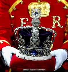 The Imperial State Crown being carried from The House of Lords following the end the State Opening of Parliament.