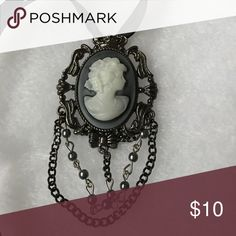 Vintage style cameo pendant This vintage style black and grey cameo pendant is the perfect touch of class. Black ribbon included. Vintage Jewelry