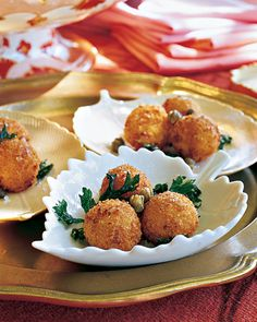 Crab Puffs    Combine lump crabmeat with Parmesan-cream sauce, parsley, and lemon zest, and chill the mixture overnight so it's easy to handle. Coat balls of the crab filling with breadcrumbs and fry until golden.