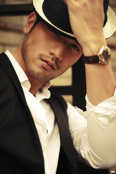 Accessorize...fedora and watch. It's all about the finishing touches!