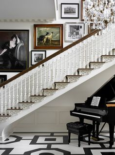 Melanie Turner: wainscoting on the walls, black and white goemterical floors and a big piano in the foyer.