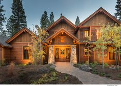 Located in Martis Camp in Lake Tahoe. Outside is landscaped. Large driveway and garage. Custom cut stacked stone for entrance, and beautiful outside finishes.