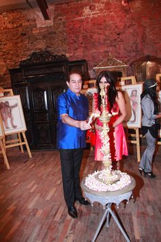Dilip Tahil and Nisha JamVwal lighting the lamp  at an evening to celebrate Art Week at The Great Eastern Homes