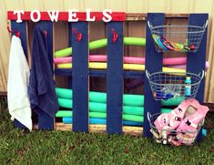 Pallet swimming pool storage for towels and toys