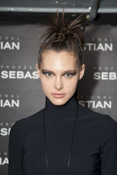 Greta Constantine Fall 2013 backstage #beauty - smoky #eyes, nude #lips and #hairstyle. See more at http://www.fashionmagazine.com/blogs/backstage-beauty/