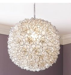 Capiz-Shell Pendant Light - Like a big beautiful flower, the Capiz Shell Pendant Light will become a beautiful focal point wherever it is hung. It is composed of translucent capiz shells fashioned into flowers and edged with silvery metal. Capiz Shell Chandelier, Shell Pendant, Modern Chandelier, Round Pendant, Chandelier Lighting, Chandeliers, Flower Chandelier, Flower Pendant, Flower Lampshade