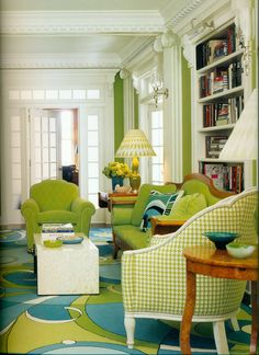 I love the Pucci inspired rug, the apple green houndstooth, and the gorgeous millwork. This room is fabulously stylish.