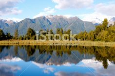 Lake Matheson, Tai Poutini National Park, New Zealand Royalty Free Stock Photo New Zealand Landscape, New Zealand Travel, Travel And Tourism, Image Now, Wilderness, Reflection, National Parks, Landscapes, Scenery